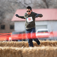 Lee Cucciardi makes his way through the obstacle course in the Quad Kids race, Saturday, Feb. 16 in Grants during the Mt. Taylor Winter Quadrathlon.