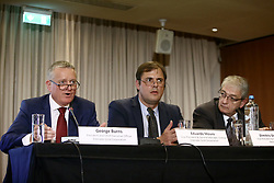 September 11, 2017 - Athens, Greece - From left: George Burns, President and chief executive officer of Eldorado Gold corporation, Eduardo Mura, Vice President and general manager, Greece Eldorado Gold and Dimitris Dimitriadis Vice President and managing director of Hellas Gold, during a press conference, in Athens on September 11, 2017. Eldorado Gold announced on Monday that it will suspend its operations in Greece, following a three months of unsuccessful negotiations and talks with the energy and environment ministry. (Credit Image: © Panayotis Tzamaros/NurPhoto via ZUMA Press)