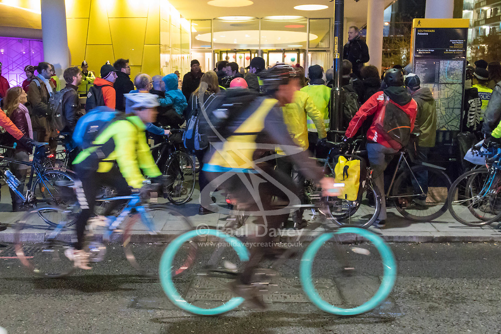 """TFL Headquarters, London. November 27th 2015. Cyclists bring traffic to a standstill as they stage their third annual """"No More Coffins Die-In and Vigil"""", highlighting the need for extra provision to be made for London's increasing number of people using bicycles for commuting and leisure, placing symbolic coffins in memory of each of the 21 cyclists killed on the capital's roads, since the November 2013. //// FOR LICENCING CONTACT: paul@pauldaveycreative.co.uk TEL:+44 (0) 7966 016 296 or +44 (0) 20 8969 6875. ©2015 Paul R Davey. All rights reserved."""