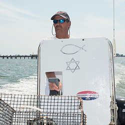 "August 4, 2017 - Tangier Island, VA - Tangier Island Mayor James ""Ooker"" Eskridge gives a tour of the area around Tangier Island from his skiff.  The mayor makes his living as a waterman crabbing and raising crabs till they molt.  <br /> <br /> Photo by Susana Raab/Institute"