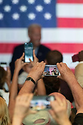 Supporters take camera phone pictures of Former Vice President Joe Biden during a town hall meeting at the International Longshoreman's Association Hall July 7, 2019 in Charleston, South Carolina.
