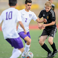 Miyamura Patriot Steven Marquez (2) dribbles to the goal while playing the Aztec Tigers at Miyamura High School in Gallup Thursday.