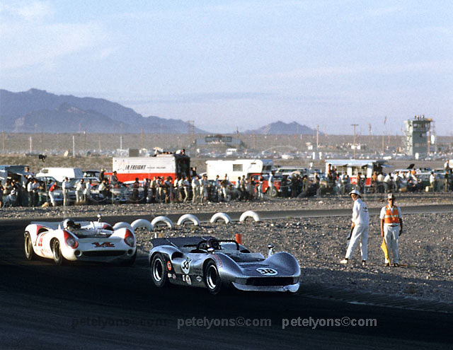 McLaren M1C of Ron Herrera (38) and Lola T70 of Bud Morley in 1967 Las Vegas Can-Am; PLEASE CREDIT photo by Pete Lyons / www.petelyons.com
