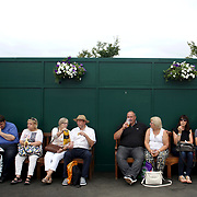 LONDON, ENGLAND - JULY 16: Fans relax at Wimbledon on Men's Final Day during the Wimbledon Lawn Tennis Championships at the All England Lawn Tennis and Croquet Club at Wimbledon on July 16, 2017 in London, England. (Photo by Tim Clayton/Corbis via Getty Images)