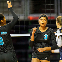 Navajo Prep Eagle Leshauntai Adams (9), left,  and Jasmine Coleman (3) celebrate after scoring on the Santa Fe Prep Blue Griffins during the state volleyball tournament at the Santa Ana Star Center in Rio Rancho Friday.