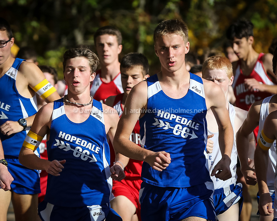 (10/14/14, HOPEDALE, MA) Hopedale's Ryan Wollensak, left, and Yaroslav Borodenko compete in the cross country race against Milford at Draper Field in Hopedale on Tuesday. Daily News and Wicked Local Photo/Dan Holmes