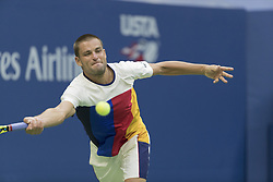 August 31, 2017 - New York, New York, United States - Mikhail Youzhny of Russia returns ball during match against Roger Federer of Switzerland at US Open Championships at Billie Jean King National Tennis Center  (Credit Image: © Lev Radin/Pacific Press via ZUMA Wire)