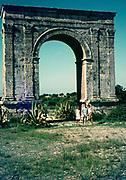 Arc de Bera, Roman Triumphal arch, Roda de Bera, Tarragona province, Catalonia, Spain 1966 three tourists standing