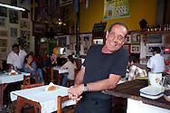 Peru, Lima, Barranco. Vicente Cardoso, restaurant owner  Canta Rana portrait in his restaurant