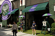The Wimbledon tennis tournament sponsor Ralph Lauren has its shop front transformed into an outdoor cafe, complete with tennis umpires and ball girls on Bond Street on 2nd July 2021 in London, United Kingdom. Now that the roadmap for coming out of the national lockdown and easing of restrictions is set, dome medical professionals are suggesting thatsome safety measures are kept in place because of the increase in the Delta variant.