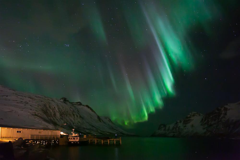 A coronal Aurora Borealis (Northern Lights) at Ersfjordbotn in Tromso, Norway.