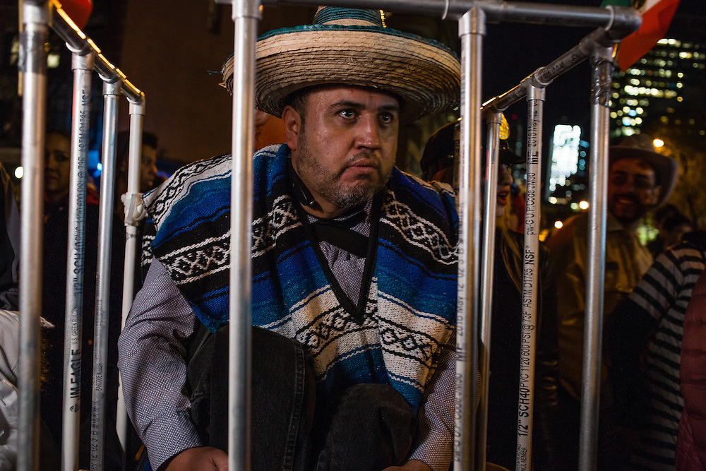 New York, NY - 31 October 2016. A m an costumed as a Mexican, with sombrero and serape, in a cage was protesting Trump's proposals to stop immigration from Mexico.