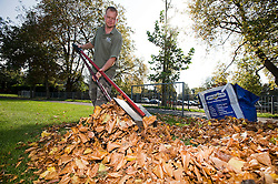 © Licensed to London News Pictures. Henley-On-Thames, UK  03/10/2011. A gardener clearing autumn leaves from a field in Henley-on-Thames, Oxfordshire today. Photo credit: LNP