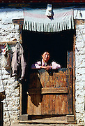 Woman at doorway of house, Paro, Bhutan