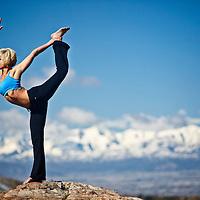Woman performs Natarajasana yoga position in Big Cottonwood Canyon, Utah