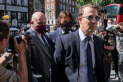 © Licensed to London News Pictures. 06/07/2020. London, UK. US actor Johhny Depp(centre) arrives at The Hight Court in Central London. Johnny Depp's libel trial against The Sun newspaper is due to take place over the next three weeks over allegations he was violent and abusive towards his ex-wife Amber Heard. Photo credit: Rob Pinney/LNP
