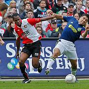 NLD/Rotterdam/20100919 - Voetbalwedstrijd Feyenoord - Ajax 2010, Luis Suarez in duel met