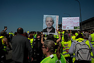 The gilet jaunes have not just one demand, each one is bringing a cause to the protest. Like freedom for Julian Assange.