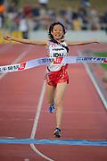Nov 24, 2014; Chiba, JAPAN; Ayumi Hagiwara celebrates after running the sixth stage on the Japan team that won in 2:05:53 in the 2014 Chiba International Ekiden. Photo by Kazuo Tanaka