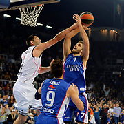 Anadolu Efes's Stratos Perperoglou (R) during their Turkish Airlines Euroleague Basketball PlayOffs Round 3 match Anadolu Efes between Real Madrid at Abdi ipekci arena in Istanbul, Turkey, Tuesday April 21, 2015. Photo by Aykut AKICI/TURKPIX