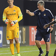 Joe Hart, (left), Manchester City, receives advice from Assistant Manager Brian Kidd during the Manchester City Vs Liverpool FC Guinness International Champions Cup match at Yankee Stadium, The Bronx, New York, USA. 30th July 2014. Photo Tim Clayton
