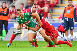 Luca Sperandio of Benetton Treviso is tackled by Leigh Halfpenny of Scarlets<br /> <br /> Photographer Craig Thomas/Replay Images<br /> <br /> Guinness PRO14 Round 3 - Scarlets v Benetton Treviso - Saturday 15th September 2018 - Parc Y Scarlets - Llanelli<br /> <br /> World Copyright © Replay Images . All rights reserved. info@replayimages.co.uk - http://replayimages.co.uk