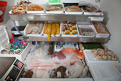 Display of seafood in the back of a fishmongers van