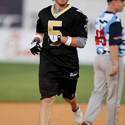 Apr 28, 2010; Metairie, LA, USA; Garrett Hartley (5) runs the bases after hitting a homerun during the Heath Evans Foundation charity softball game featuring teammates of the Super Bowl XLIV Champion New Orleans Saints at Zephyrs Field.  Mandatory Credit: Derick E. Hingle-US-PRESSWIRE.