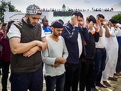 June 15, 2018 - Seoul, Gyeonggi, South Korea - Men pray at Seoul Central Mosque on Eid al Fitr, the Muslim Holy Day that marks the end of the Holy Month of Ramadan. There are fewer than 100,000 Korean Muslims, but there is a large community of Muslim immigrants in South Korea, most in Seoul. Thousands of people attend Eid services at Seoul Central Mosque, the largest mosque in South Korea. (Credit Image: © Jack Kurtz via ZUMA Wire)