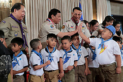 April 3, 2017 - Manila, Philippines - Philippine President Rodrigo Duterte receives a high-five from a young boy scout in Rizal Hall at the Malacanang Palace April 3, 2017 in Manila, Philippines. The event celebrated Baden Powell Day, founder of the World Scout Organization. (Credit Image: © Robinson Ninal Jr/Planet Pix via ZUMA Wire)