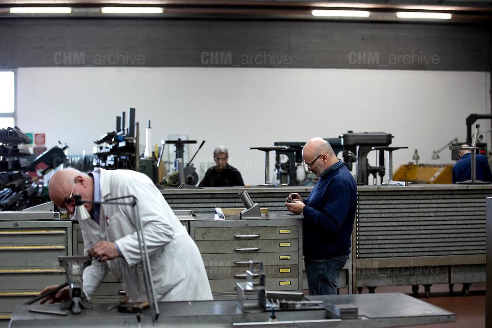 Dipendenti della Mivar al lavoro all'interno della fabbrica, Abbiategrasso 18 marzo 2014. Guido Montani / OneShot