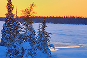 Sunset light on Setting Lake in winter<br /> Sasagiu Rapids<br /> Manitoba<br /> Canada