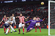 Harry Kane of Tottenham Hotspur (l) takes a shot at goal but sees it go over the crossbar.  Premier league match, Tottenham Hotspur v Stoke City at Wembley Stadium in London on Saturday 9th December 2017.<br /> pic by Steffan Bowen, Andrew Orchard sports photography.