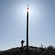 Pilgrim arriving to the Cruz de Ferro or Iron Cross in Irago mountain, Leon province . Spain . The WAY OF SAINT JAMES or CAMINO DE SANTIAGO following the French Route, between Saint Jean Pied de Port and Santiago de Compostela in Galicia, SPAIN. Tradition says that the body and head of St. James, after his execution circa. 44 AD, was taken by boat from Jerusalem to Santiago de Compostela. The Cathedral built to keep the remains has long been regarded as important as Rome and Jerusalem in terms of Christian religious significance, a site worthy to be a pilgrimage destination for over a thousand years. In addition to people undertaking a religious pilgrimage, there are many travellers and hikers who nowadays walk the route for non-religious reasons: travel, sport, or simply the challenge of weeks of walking in a foreign land. In Spain there are many different paths to reach Santiago. The three main ones are the French, the Silver and the Coastal or Northern Way. The pilgrimage was named one of UNESCO's World Heritage Sites in 1993. When there is a Holy Compostellan Year (whenever July 25 falls on a Sunday; the next will be 2010) the Galician government's Xacobeo tourism campaign is unleashed once more. Last Compostellan year was 2004 and the number of pilgrims increased to almost 200.000 people.