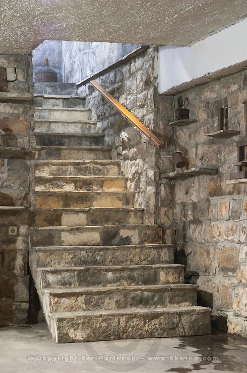 Stone steps stairs leading down to the wine cellar. Matusko Winery. Potmje village, Dingac wine region, Peljesac peninsula. Matusko Winery. Dingac village and region. Peljesac peninsula. Dalmatian Coast, Croatia, Europe.