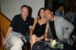 Left to right, SIMON MILLS, ANNABEL STRINGER and GUY PRATT at an Evening with Notting Hill Guitars held at 167 Westbourne Grove, London W11 on 4th September 2013.