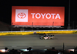 March 1, 2019 - Las Vegas, NV, U.S. - LAS VEGAS, NV - MARCH 01: Kyle Busch (51) KBM Toyota Tundra drives under the Toyota billboard in turn 2 during the NASCAR Gander Outdoors Truck Series Strat 200 on March 01, 2019, at Las Vegas Motor Speedway in Las Vegas, NV. (Photo by Chris Williams/Icon Sportswire) (Credit Image: © Chris Williams/Icon SMI via ZUMA Press)