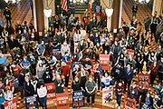 "11 JANUARY 2021 - DES MOINES, IOWA: People listen to speakers talk about personal freedoms and masks in the Rotunda of the Iowa State Capitol in Des Moines. Hundreds of Iowans from across the state came to the State Capitol to protest the Governor's COVID-19 mitigation efforts. The Coronavirus (SARS-CoV-2) mitigation guidelines include a mask mandate indoors when it isn't possible to social distance. But the Governor specifically exempted the State Capitol. No one in the crowd wore a mask and there was no effort to follow ""social distancing"" guidelines. There were also ""anti-Vaxxers"" in the crowd who protested the vaccine efforts and said vaccines were unsafe.           PHOTO BY JACK KURTZ"