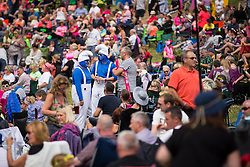 """© Licensed to London News Pictures . 09/08/2015 . Siddington , UK . """" Smurfs """" in the crowd . The Rewind Festival of 1980s music , fashion and culture at Capesthorne Hall in Macclesfield . Photo credit: Joel Goodman/LNP"""