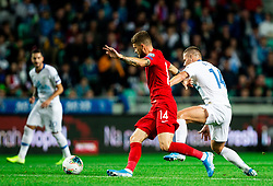 Mateusz Klich of Poland vs Roman Bezjak of Slovenia during the 2020 UEFA European Championships group G qualifying match between Slovenia and Poland at SRC Stozice on September 6, 2019 in Ljubljana, Slovenia. Photo by Vid Ponikvar / Sportida