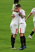 SEVILLE, SPAIN - OCTOBER 28: Luuk de Jong and Lucas Ocampos of FC Sevilla during the UEFA Champions League Group E stage match between FC Sevilla and Stade Rennais at Estadio Ramon Sanchez-Pizjuan on October 28, 2020 in Seville, Spain. (Photo by Juan Jose Ubeda/ MB Media).