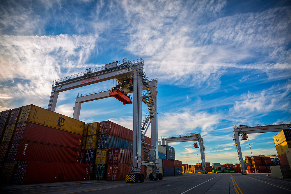 Containers and ship to shore cranes working vessels at the Georgia Ports Authority Garden City Terminal, Thursday, Feb., 8, 2018, in Savannah, Ga.  (GPA Photo/Stephen B. Morton)