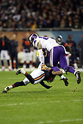 Minnesota Vikings tight end Kyle Rudolph (82) gets tackled by a defender as he catches a pass for a gain of 11 yards and a first down at the Vikings 41 yard line with less than one minute left in the third quarter during the 2016 NFL week 8 regular season football game against the Chicago Bears on Monday, Oct. 31, 2016 in Chicago. The Bears won the game 20-10. (©Paul Anthony Spinelli)