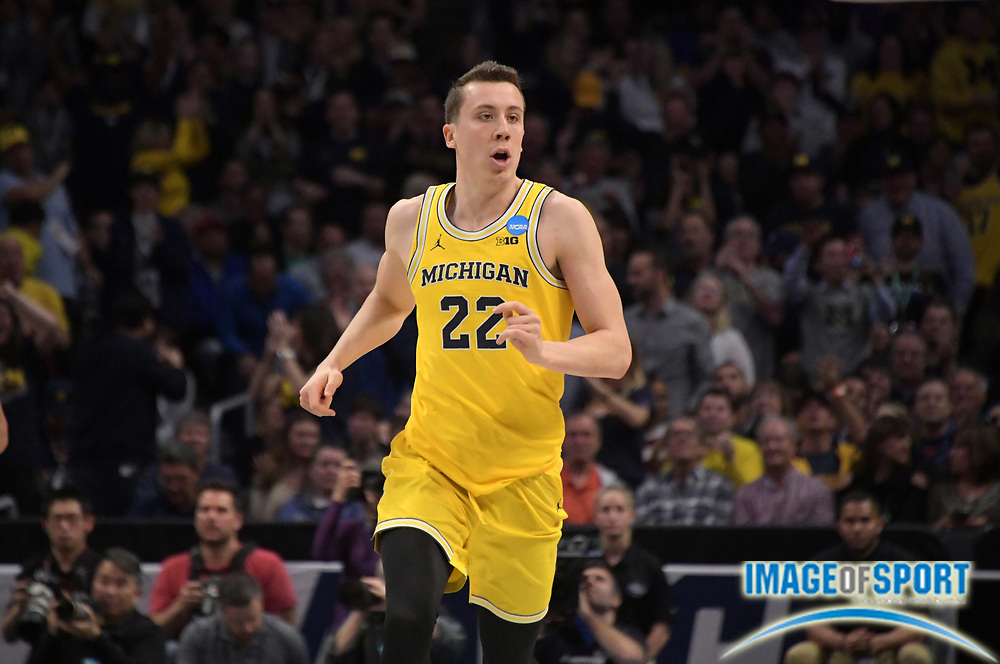 Michigan Wolverines guard Duncan Robinson (22) celebrates during a West Regional semifinal of the NCAA men's college basketball tournament against the Texas A&M Aggies, Thursday, March 22, 2018, in Los Angeles. Michigan defeated Texas A&M 99-72.