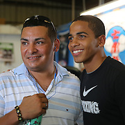 ORLANDO, FL - Felix Verdejo (R) poses with a fan during his media day workout at the Orlando Sports Martial Arts Academy on October 2, 2014 in Orlando, Florida. (Photo by Alex Menendez/Getty Images) *** Local Caption *** Felix Verdejo