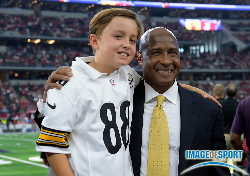 Sep 3, 2016; Arlington, TX, USA; USC Trojans athletic director Lynn Swann (right) poses with a young fan before the game at AT&T Stadium.