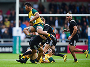 Australia's Robert Leota jumps over an attempted tackle during the World Rugby U20 Championship 5rd Place play-off  match Australia U20 -V- New Zealand U20 at The AJ Bell Stadium, Salford, Greater Manchester, England on Saturday, June  25  2016.(Steve Flynn/Image of Sport)