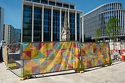 Scene at Chamberlain Square which is under redevelopment as the Coronavirus lockdown continues, the city centre is still very quiet while more traffic and people are returning, and with restrictions due to be relaxed further in the coming days, the quiet city may be coming to an end as businesses are set to start to reopen soon on 27th May 2020 in Birmingham, England, United Kingdom. Coronavirus or Covid-19 is a respiratory illness that has not previously been seen in humans. While much or Europe has been placed into lockdown, the UK government has put in place more stringent rules as part of their long term strategy, and in particular social distancing.