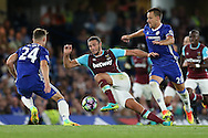 Andy Carroll of West Ham United is challenged by John Terry, the Chelsea captain. Premier league match, Chelsea v West Ham United at Stamford Bridge in London on Monday 15th August 2016.<br /> pic by John Patrick Fletcher, Andrew Orchard sports photography.
