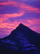 Sunrise illuninating clouds beyond Cirrus Mountain, Banff National Park, Alberta, Canada.